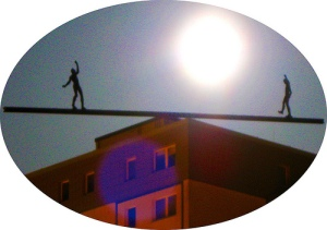 see-saw on the edge of a building